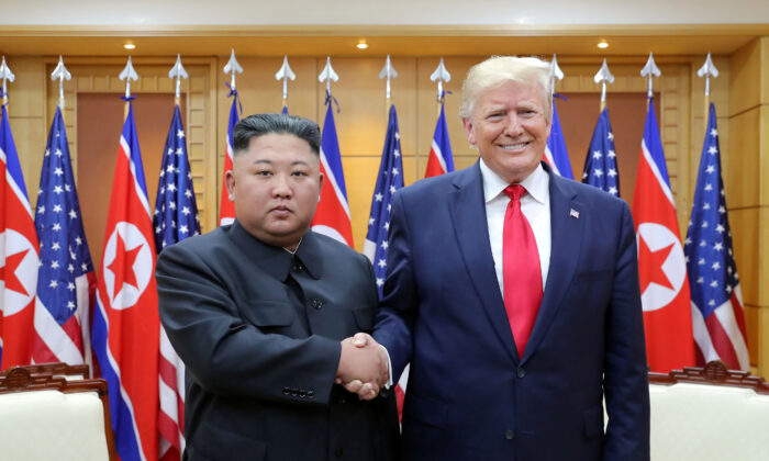 President Donald Trump shakes hands with North Korean leader Kim Jong Un as they meet at the demilitarized zone separating the two Koreas, in Panmunjom, South Korea, on June 30, 2019. (KCNA via Reuters)