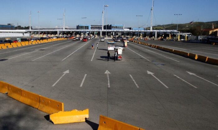 A general view shows an almost empty Mexico-U.S. San Ysidro border crossing after the United States and Mexico have agreed to restrict non-essential travel over their shared border to limit the spread of the CCP virus, in Tijuana, Mexico, on March 21, 2020. (Jorge Duenes/Reuters)