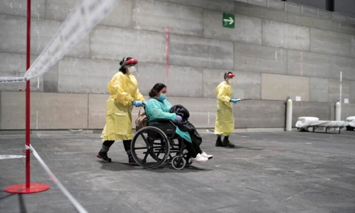 CCP virus patients arrive at a military hospital set up at the IFEMA conference centre in Madrid, Spain,  on March 21, 2020. (Comunidad de Madrid/Handout via Reuters)