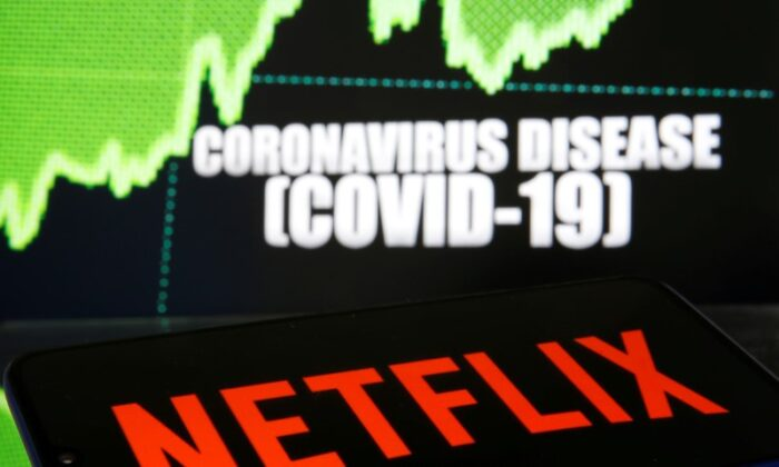 Netflix logo is seen in front of diplayed coronavirus disease in this illustration taken on March 19, 2020. (Dado Ruvic/Illustration/Reuters)