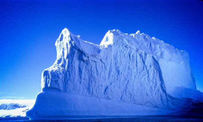 Antarctica is the only place on Earth where you can see stretches of stunning blue ice. (Copyright Fred J. Eckert)