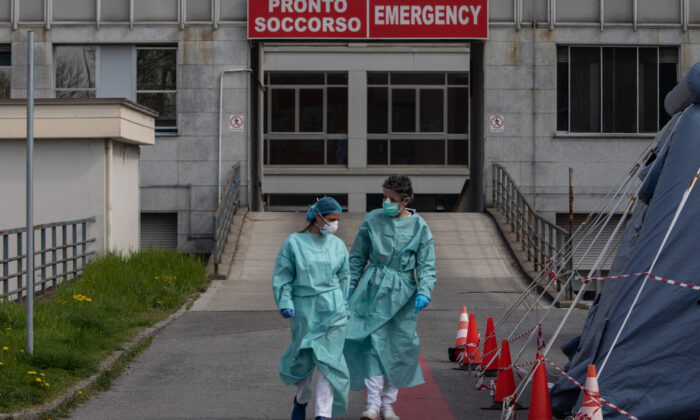 Two nurses walk in front of the Emergency Room of the local hospital in Cremona, near Milan, Italy, on March 20, 2020. (Emanuele Cremaschi/Getty Images)