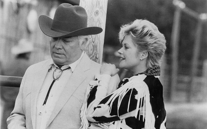 man with cowboy hat and woman with short hair in 'The Milagro Beanfield War'