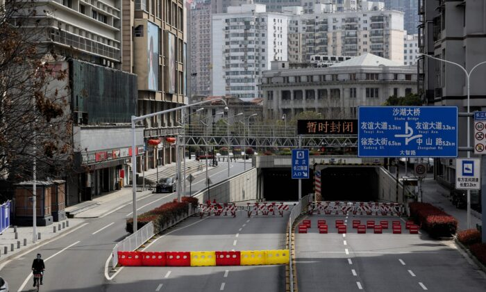 Barriers set up to block off a street in Wuhan, China, on March 15, 2020. The normally bustling city in central China is the epicentre of COVID-19 and a symbol of the Chinese economy's shutdown in the first quarter of 2020. (STR/AFP via Getty Images)