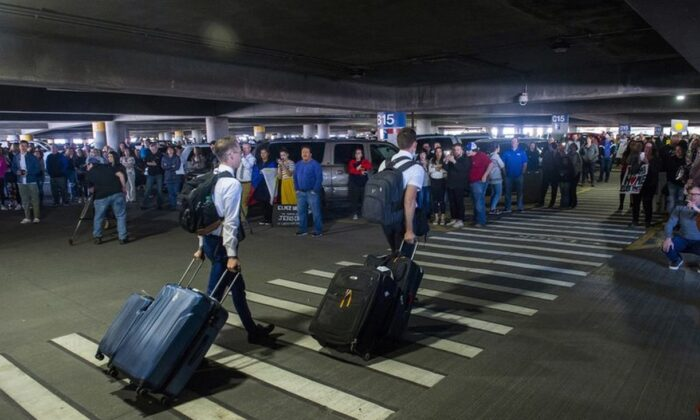 Hundreds of people gather to welcome missionaries returning home from the Philippines at the Salt Lake City International Airport on March 22, 2020. (Rick Egan/The Salt Lake Tribune via AP)