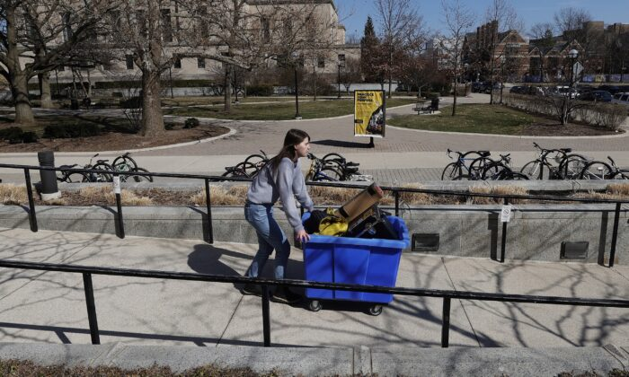 A student moves out of her dorm at the University of Michigan on March 17, 2020. (Gregory Shamus/Getty Images)