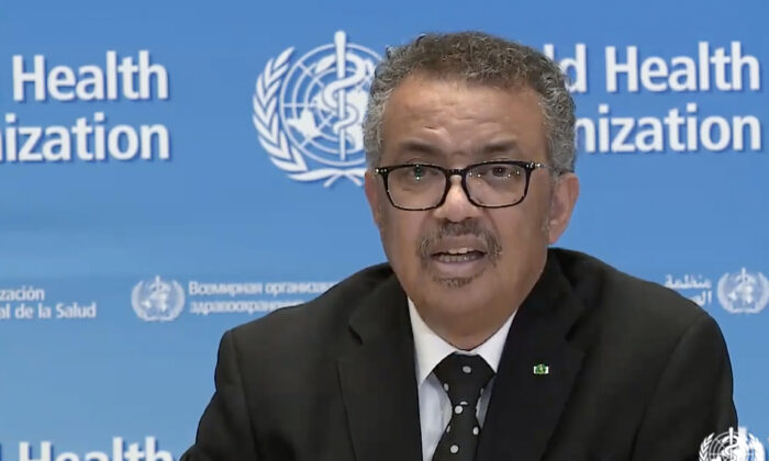 WHO Chief Tedros Adhanom Ghebreyesus delivering a virtual news briefing on the CCP virus at the WHO headquarters in Geneva on March 23, 2020. (AFP via Getty Images)