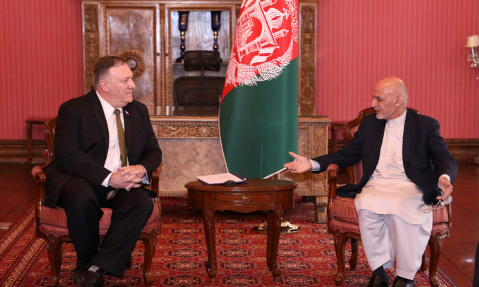 Afghanistan's President Ashraf Ghani (R) meets with U.S. Secretary of State Mike Pompeo in Kabul, Afghanistan, on March 23, 2020. (Afghan Presidential Palace Handout via Reuters)
