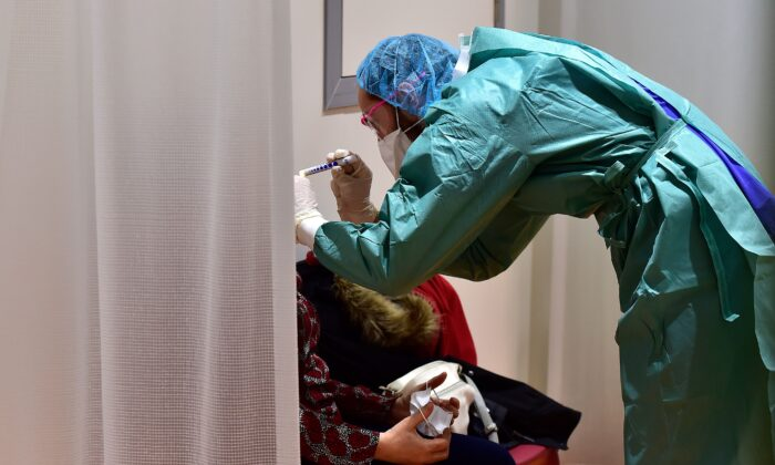 A doctor examines a patient at the hospital screening unit of the CHU Pellegrin in Bordeaux, southwestern France  (Georges Gobet/AFP via Getty Images)