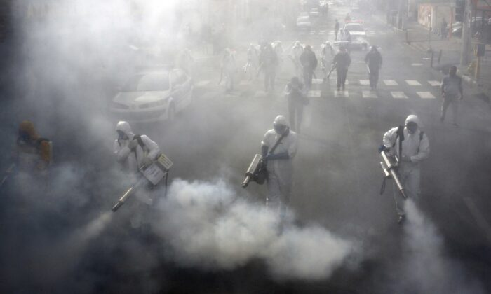 Iranian Firefighters disinfect streets in the capital Tehran in a bid to halt the wild spread of coronavirus on March 13 2020. (AFP via Getty Images)