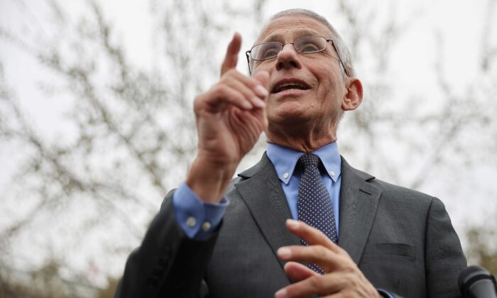 National Institute Of Allergy And Infectious Diseases Director Anthony Fauci talks to reporters about the Trump administration's response to the global coronavirus outbreak outside the White House on March 12, 2020. (Chip Somodevilla/Getty Images)