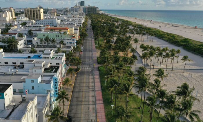 In this aerial view from a drone, desolate Ocean Drive is seen after most visitors have checked out of their hotels in a citywide effort to contain the coronavirus in Miami Beach, Fla., on March 24, 2020. (Joe Raedle/Getty Images)