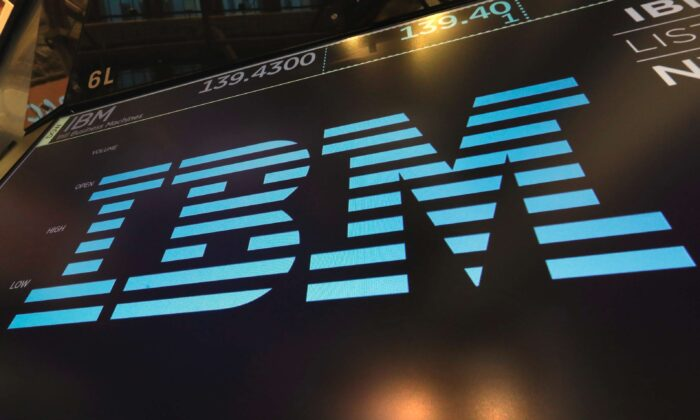 The logo for IBM appears above a trading post on the floor of the New York Stock Exchange on March 18, 2019. (Richard Drew, File/AP Photo)
