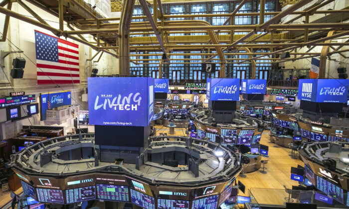 This photo provided by the New York Stock Exchange shows the unoccupied NYSE trading floor, closed temporarily for the first time in 228 years as a result of the CCP virus, on March 24, 2020. (Kearney Ferguson via AP)