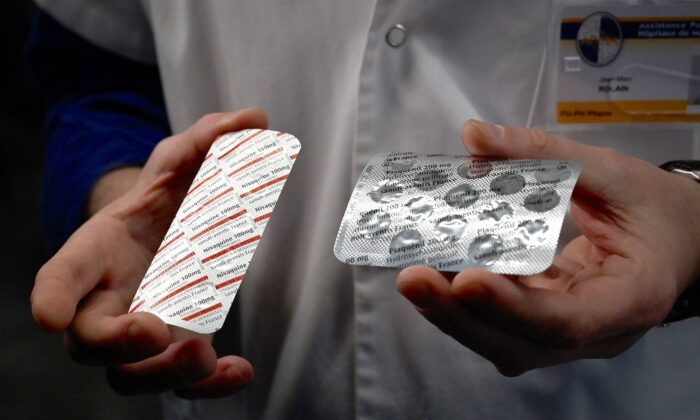 A medical staffer shows tablets containing chloroquine, a drug that has shown signs of effectiveness against the virus that causes COVID-19, in Marseille, France, on Feb. 26, 2020. (Gerard Julien/AFP/Getty Images)