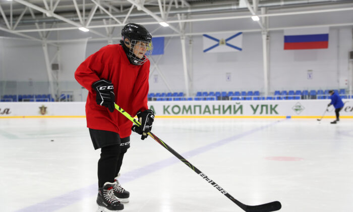 Valentina Fyodorova, 80, the captain of a senior women's hockey team, attends a training session in the village of Bereznik in Arkhangelsk region, Russia, March 5, 2020. (REUTERS/Evgenia Novozhenina)
