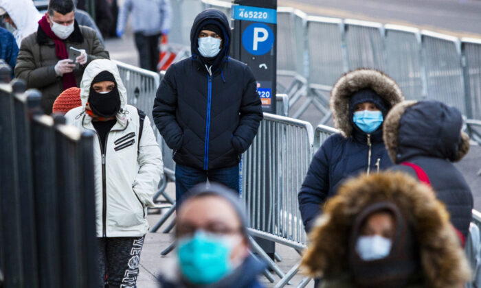 People line up to get a test at Elmhurst Hospital due to CCP virus outbreak. in Queens, New York, United States on March 24, 2020. (Eduardo Munoz Alvarez/Getty Images)