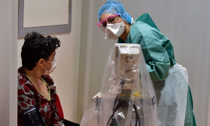 A medical staff member examines a patient at a hospital in Bordeaux, France, on March 9, 2020. (Georges Gobet/AFP/Getty Images)