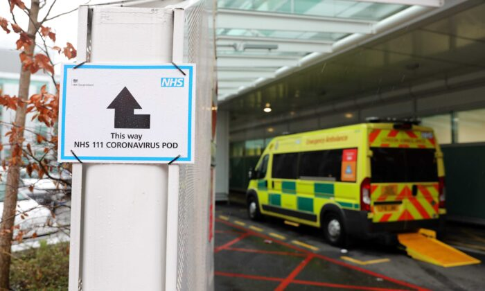 A sign directs patients to an NHS 111 Coronavirus Pod, where people who believe they may be suffering from the virus can attend and speak to doctors, outside University College Hospital in London on March 5, 2020. (Isabel Infantes/AFP via Getty Images)