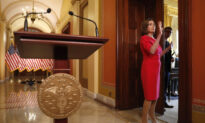 Man in Viral Photo Carrying Pelosi's Lectern Is Arrested