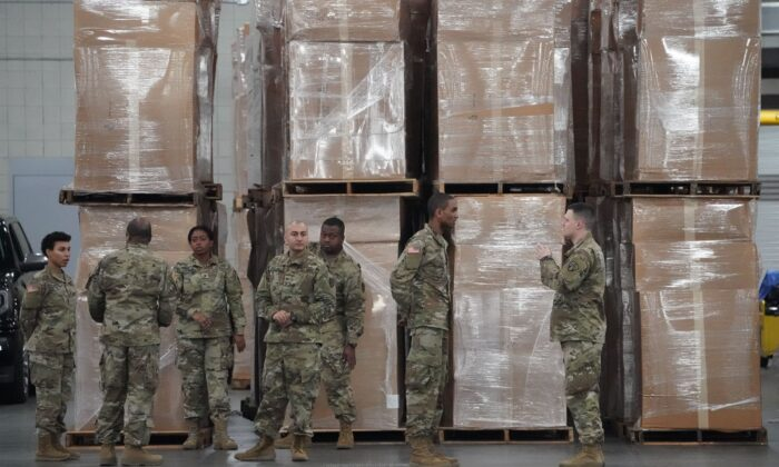 U.S. Army National Guard members walk through the Jacob Javits Center on Manhattan's West Side in New York City on March 23, 2020. (Bryan R. Smith/AFP/Getty Images)