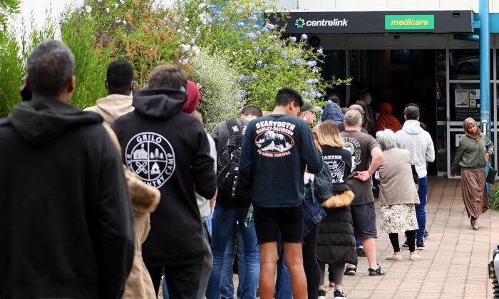People are seen lining up at Centrelink in Flemington on March 23, 2020 in Melbourne, Australia. (Quinn Rooney/Getty Images)