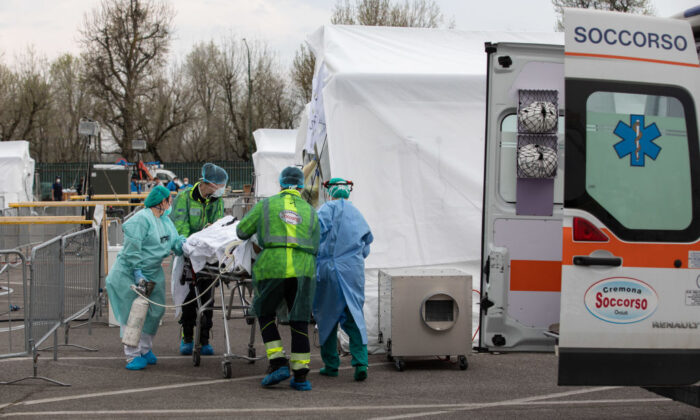 A patient is treated by a doctor at a Samaritan's Purse Emergency Field Hospital on March 20, 2020, in Cremona, near Milan, Italy. Thanks to a 68-bed respiratory unit, 32 members of Samaritan's Purse disaster response team will provide medical care during the CCP virus pandemic. (Emanuele Cremaschi/Getty Images)