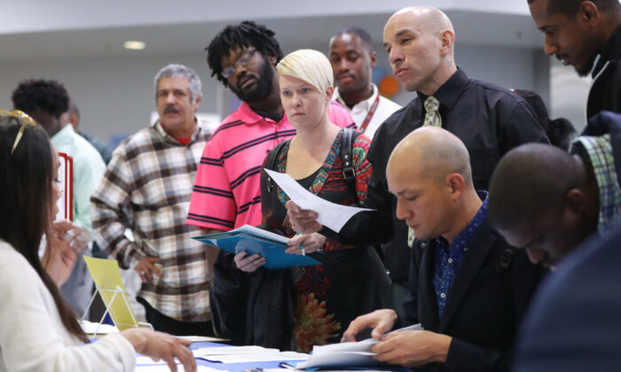 Job seekers meet with recruiters at a job fair hosted by the Los Angeles Mission on March 5, 2020 in Los Angeles. (Mario Tama/Getty Images)