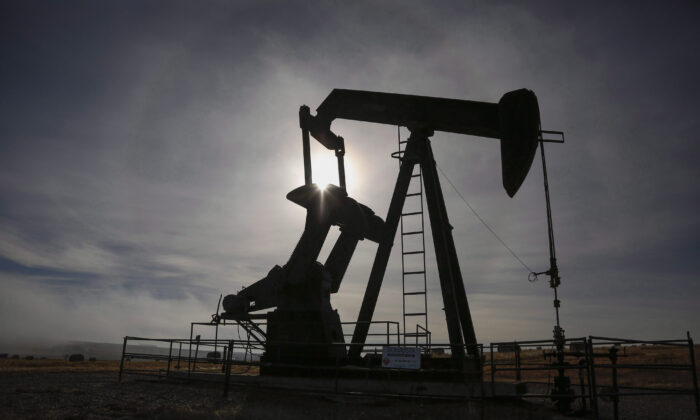 Apumpjackworks at a well head on an oil and gas installation near Cremona, Alta., in this file photo. (The Canadian Press/Jeff McIntosh)