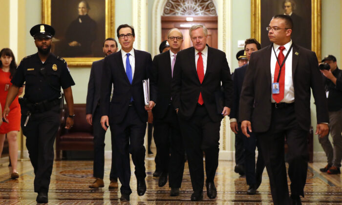 Treasury Secretary Steven Mnuchin (2L), White House Director of Legislative Affairs Eric Ueland (3L), and White House Chief of Staff Mark Meadows (4L) arrive at the U.S. Capitol to continue negotiations on a $2 trillion economic stimulus in response to the CCP virus pandemic in Washington, late March 24, 2020. (Chip Somodevilla/Getty Images)