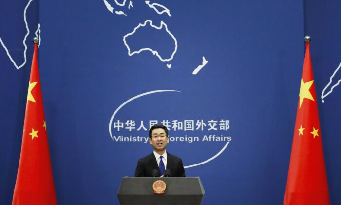 Chinese Foreign Ministry spokesman Geng Shuang speaks during a daily briefing at the Ministry of Foreign Affairs office in Beijing on March 18, 2020. American journalists were expelled from China in retaliation for a new limit imposed by the Trump administration on visas for Chinese state-owned media operating in the United States. (Andy Wong/AP Photo)