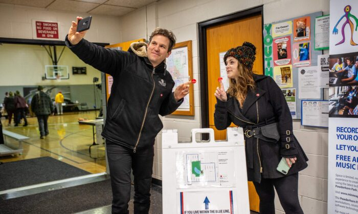 "A couple takes a ""selfie"" photo after voting at the Democratic presidential primary at Powderhorn Park Community Center in in Minneapolis, Minn., on Super Tuesday, March 3, 2020. (Kerem Yucel/AFP via Getty Images)"