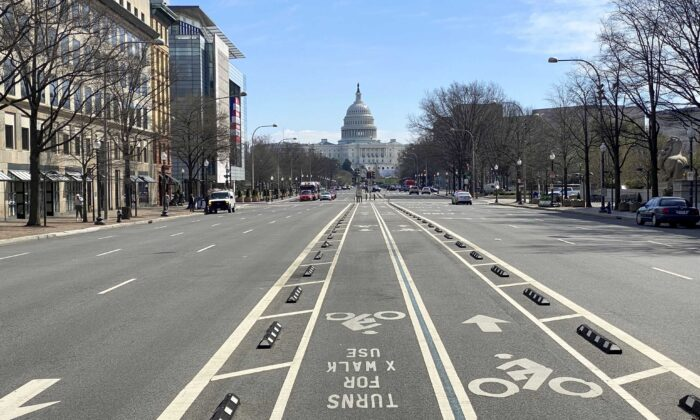An almost empty Pennsylvania Avenue is seen at noon in Washington on March 13, 2020. (Eric Baradat/AFP via Getty Images)