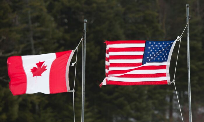 Canadian and American flags are seen at the US/Canada border in Pittsburg, N.H., on March 1, 2017. (Don Emmert/AFP via Getty Images)
