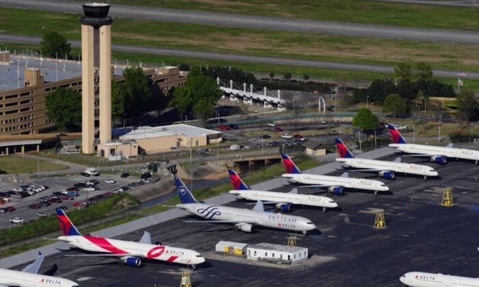 Delta Air Lines passenger planes are seen parked due to flight reductions made to slow the spread of the CCP virus (COVID-19), at Birmingham-Shuttlesworth International Airport in Birmingham, Alabama, on March 25, 2020. (Elijah Nouvelage/Reuters)