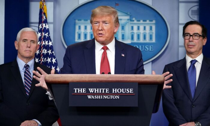 U.S. President Donald Trump speaks during a press conference on the COVID-19 outbreak flanked by Secretary of the Treasury Steven Mnuchin (R) and Vice President Mike Pence at the White House in Washington, D.C., on March 25, 2020. (Mandel Ngan/AFP via Getty Images)