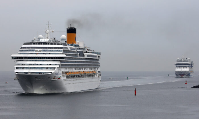 The Favolosa, left, is headed to Florida along with another ship owned by Carnival Corporation. Both have sick people on board amid the COVID-19 pandemic. (Bernd Wuestneck/DPA/AFP via Getty Images)