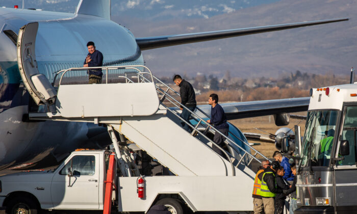 A U.S. Immigration and Customs Enforcement detainee boarding a Swift Air charter flight at McCormick Air Center on Feb. 18, 2020 in Yakima, Washington. (David Ryder/Getty Images)