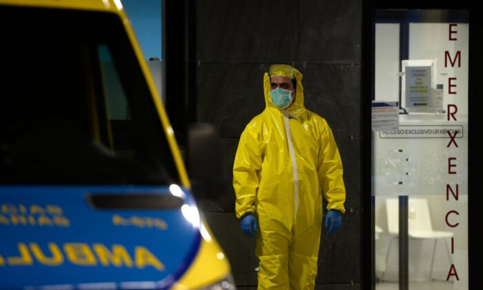 A paramedic stands outside the Alvaro Cunqueiro hospital in Vigo, northwestern Spain, on March 25, 2020. (Miguel Riopa/AFP via Getty Images)
