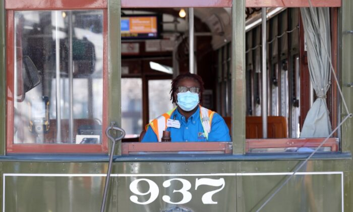 A streetcar driver wears a mask amid the outbreak of the coronavirus disease (COVID-19), in New Orleans, Louisiana on March 25, 2020. (Jonathan Bachman/Reuters)
