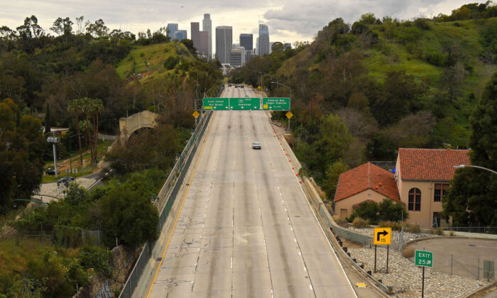 Extremely light traffic moves along the 110 Harbor Freeway toward downtown during mid afternoon, in Los Angeles, on March 20, 2020. (Mark J. Terrill/AP)