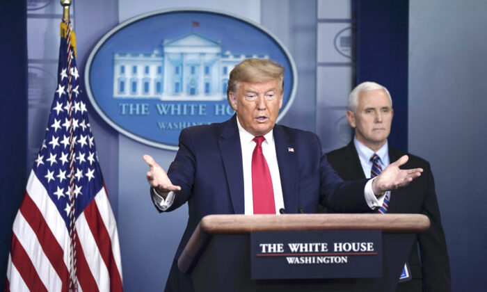 President Donald Trump and Vice President Mike Pence at a briefing on the CCP virus pandemic in the press briefing room of the White House in Washington, on March 26, 2020. (Drew Angerer/Getty Images)