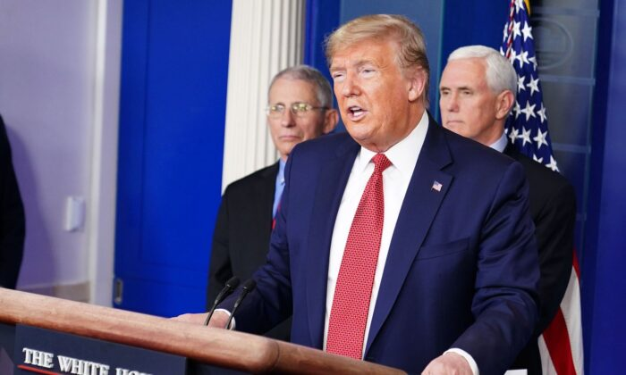 President Donald Trump speaks during the daily briefing on the CCP virus, as Director of the National Institute of Allergy and Infectious Diseases Anthony Fauci (L) and Vice President Mike Pence look on at the White House in Washington on March 25, 2020. (Mandel Ngan/AFP via Getty Images)