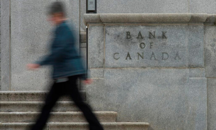 A woman walks past the Bank of Canada bulding in Ottawa in this file photo. (Adrian Wyld/The Canadian Press)