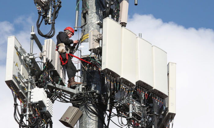 A worker rebuilds a cellular tower with 5G equipment for the Verizon network in Orem, Utah, on Nov. 26, 2019. The new 5G networks that are coming soon, will be 10x faster than the old 4G networks. (George Frey/Getty Images)