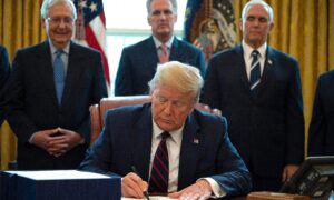 Trump Signs Largest Stimulus Bill in Modern US History