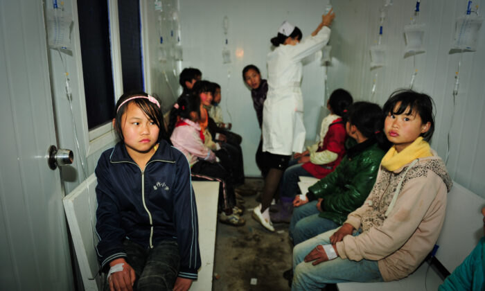 Students receive treatments at a local hospital in Zhijin County, Guizhou Province of China on March 29, 2012. (Getty Images)
