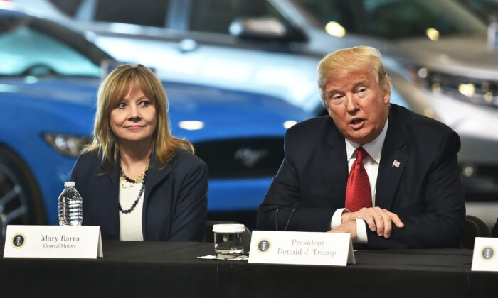 President Donald Trump at American Center for Mobility in Ypsilanti, Mich., with General Motors CEO Mary Barra and other auto industry executives on March 15, 2017. (Nicholas Kamm/AFP via Getty Images)