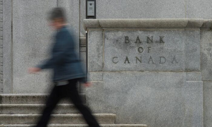 A woman walks past the Bank of Canada building in Ottawa in this file photo. (The Canadian Press/Adrian Wyld)