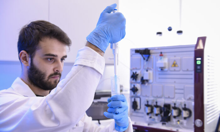 An engineering student works to separate proteins for vaccine production in Belo Horizonte, Brazil, on March 24, 2020. (Pedro Vilela/Getty Images)